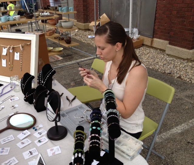 Caitlyn tweaking a piece of jewelry at one of last year's Grove Haus Eclectic Markets.