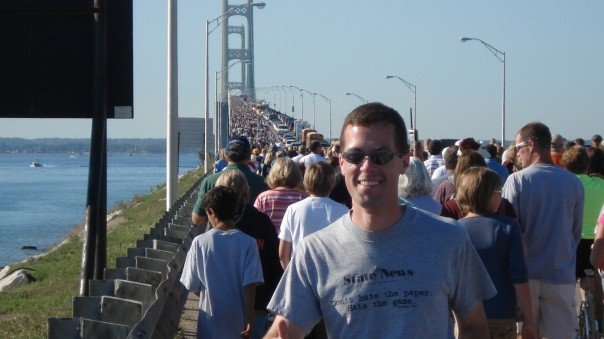 A much younger -- and less fashionable -- version of me walking across the Mighty Mac.