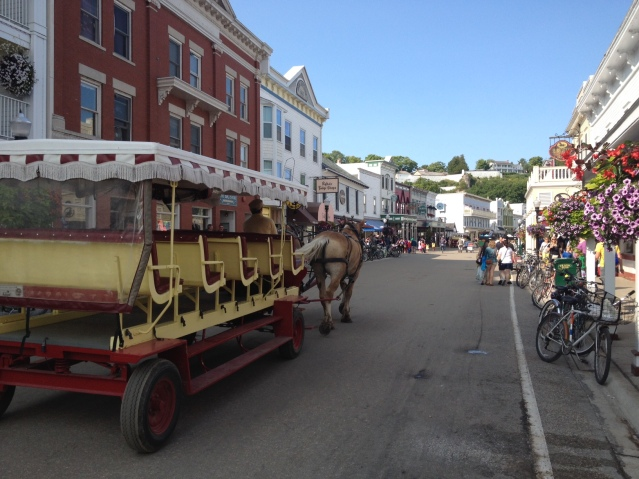 Welcome to downtown Mackinac Island. Cars need not apply...and watch your step for horse poo.