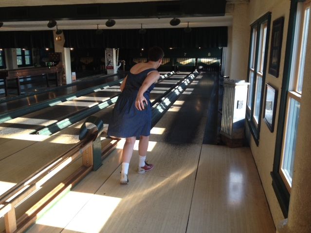 Caitlyn showing off her mad skillz at duckpin bowling.